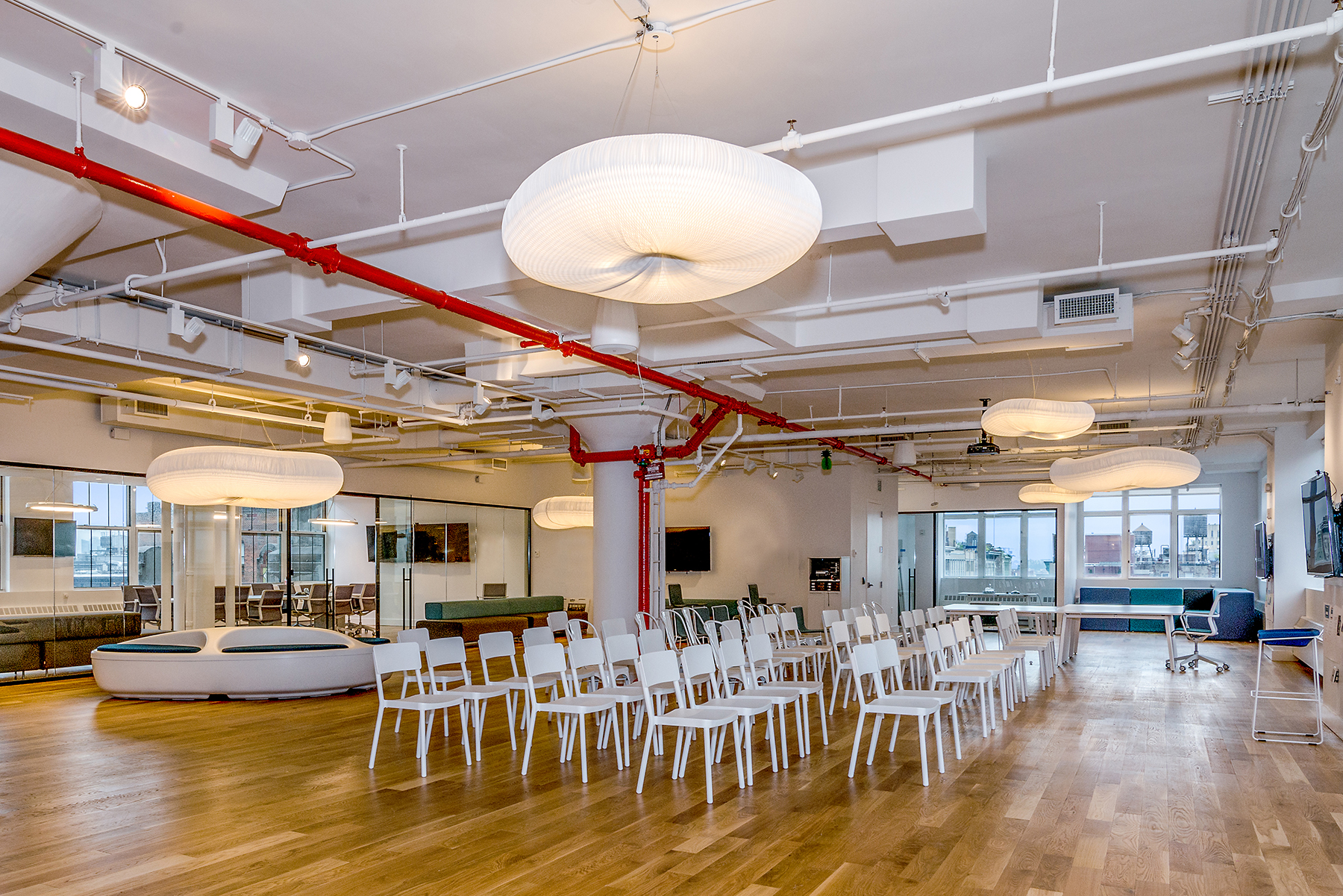 Learn about Grovo NYC's office renovation and build by Bluberry Builders, including recording studios, breakout spaces, kitchens, and a gym.
