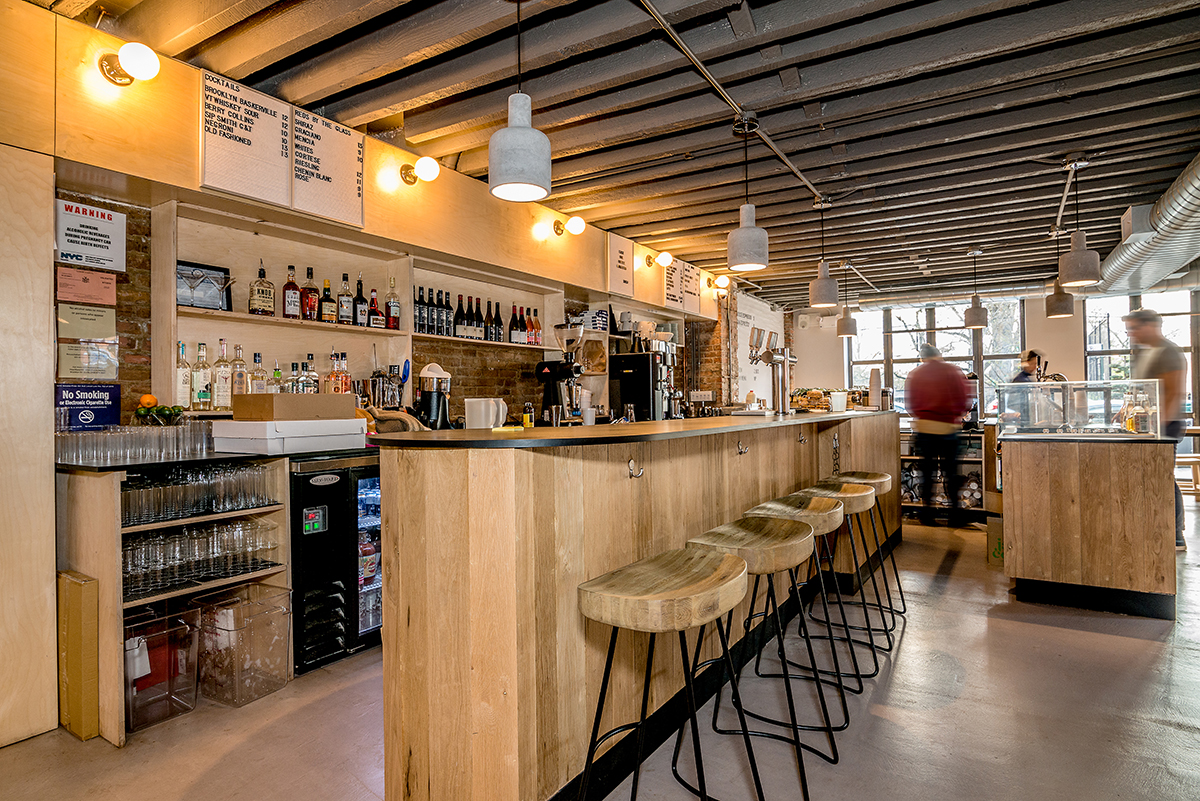 East One Coffee Roasters' cafe design by Blueberry Builders features sleek interiors for the Scandinavian cafe/restaurant.